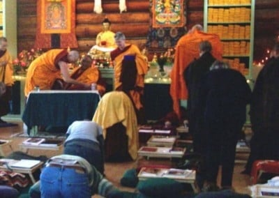 Students prostrated as Rinpoche settled into hall. The prostrations were a form of respect to the Buddha and the Dharma that he left to the world.
