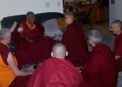 An intimate moment as the sangha watched Ven. Tarpa advise Rinpoche  on how to care for his right arm which was recently broken.