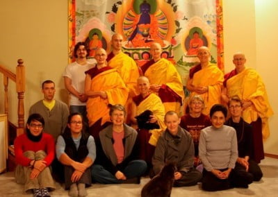 The group gathers around the Medicine Buddha thangka in the dining room for the first-day-of-retreat photo. Manjushri and Achala are ready to go into retreat too.