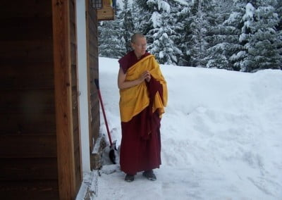 Venerable Tarpa awaits Rinpoche's arrival at the meditation hall.