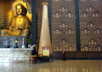Inside the Main Shrine, large bronze statues of Shakyamuni Buddha, Amitabha, and Medicine Buddha take center stage, while all four walls are lined floor to ceiling with over 14,000 small Buddha statues.