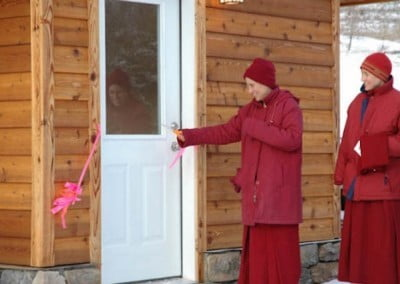 Venerable Chodron cutting the ribbon to open the meditation hall.