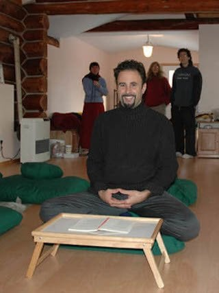 Eric sitting near one of the puja tables he donated to the Abbey.