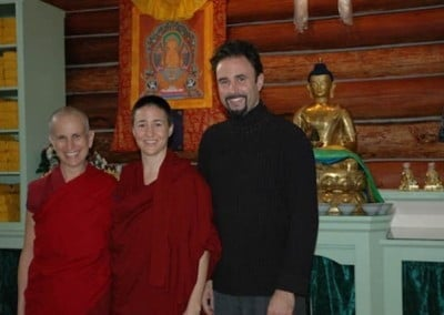 Venerable Chodron, Venerable Jampa from Deer Park Center in Madison WI and Eric, her brother and the Abbey's architect pose for a photo in front of the altar in the meditation hall