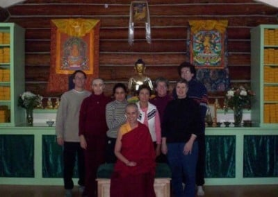 Group photo in front of the altar. From right to left: Kevin, Aida, Lupita, Flora, Nanc, Kathleen, and Miles. Venerable Chodron seated in front.
