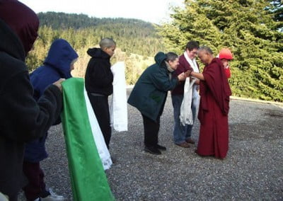 Kathleen offers kata as Rinpoche greets people  upon arrival at the Abbey.