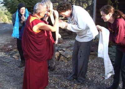 Miles offers kata as Rinpoche greets people  upon arrival at the Abbey.