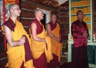 Monastics waiting in the meditation hall before Rinpoche enters.
