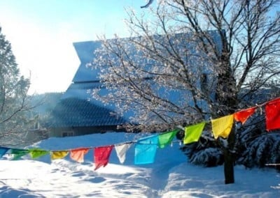 Prayer flags fluttering in front of the Abbey barn