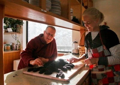 Gloria and Venerable Jigme put the finishing touches on the black sesame seed scorpion that symbolizes all our negativities created since beginningless time.