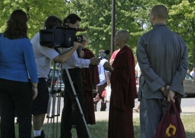 The local media covered His Holiness's visit extensively. Here a local TV station interviews Venerable Chodron.