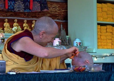 Venerable Chodron snips the last lock of hair symbolizing the cutting off of attachment.