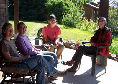 Laresa, Naomi, Katie, and Ulric take a break in the morning sun.