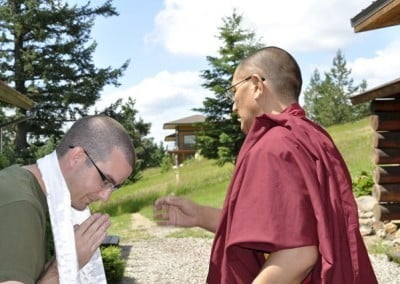 Ken welcomes Getse Rinpoche with the traditional khata offering.