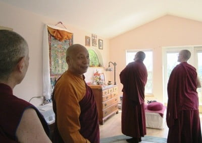 Getse Rinpoche takes a keen interest in the many beautiful holy objects that reside in Venerable's writing studio.