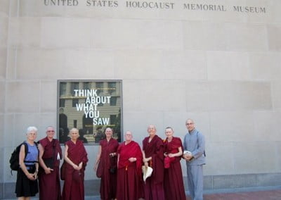 The sangha with Jon and Susan share a somber and powerful day at the Holocaust Museum. His Holiness was the first world leader to visit the Museum after it opened in 1993.