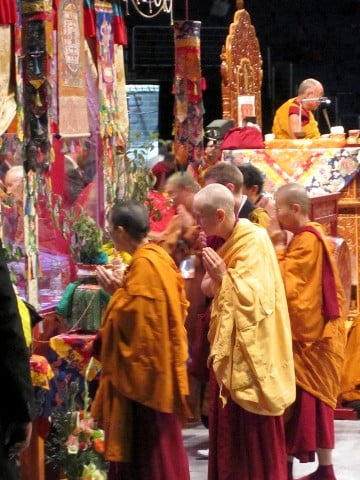 Venerable Chodron views the mandala with the sangha.