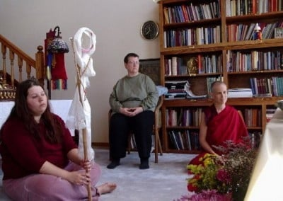 Nerea hold the mirror while Khensur Rinpoche does initial prayers.