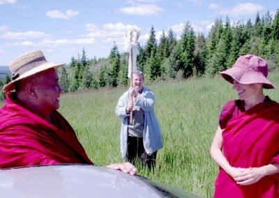 "Khensur Rinpoche now turns the mirror to catch the reflection of all parts of the  land. Rinpoche-la uses this ""miniature"" to bless the entire property."