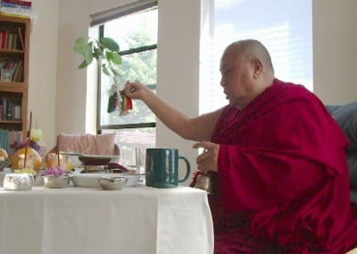 Back at the house, Khensur Rinpoche invokes the Buddhas and bodhisattvas and blesses the reflected image of the abbey's environment.