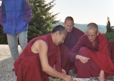 Tracy, Ven. Chodron and Ven. Tsepal watch Geshe-la preparing incense for the blessing.