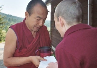 Venerable Tsepal makes an offering to Geshe Gendun.