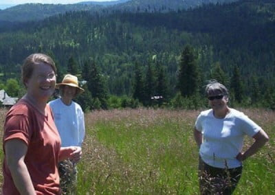 Jan (wearing the hat) takes some of the FOSA volunteers on a  walk in the grass meadow above the Abbey.