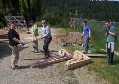 FOSA volunteers help unload and stack building trusses