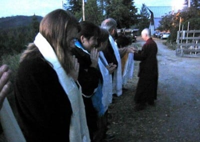 Venerable Chodron blesses each of the FOSA members as they stand in a long line outside the Abbey.