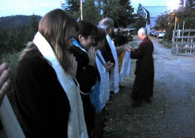 As the sun rises on Sunday (the last day of the meeting), Venerable Chodron leaves for a long trip and blesses each of the FOSA members.