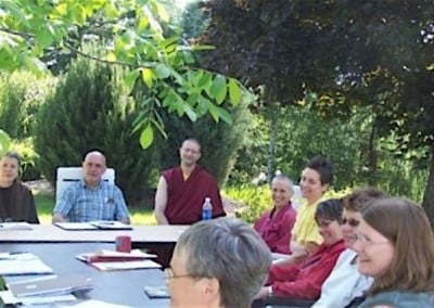 Meeting under the trees to get to know each other and and become reaquainted. Starting from the left: Co-chair Kathleen, facilitator Bill, Ven. Lobsang, Ven. Chodron, Pema (office admin), Barbara (PR chair), Debi (bookkeeper), Melanie, and Joan. Melanie (volunteer coordinator), Joan (house manager)