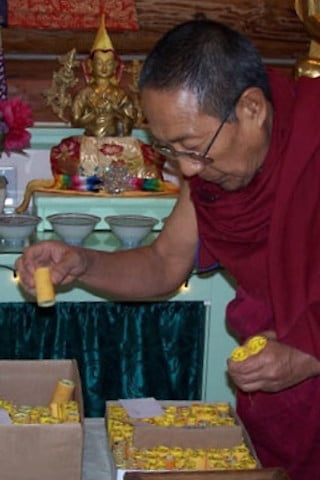 Rinpoche carefully selects mantra rolls.