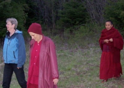 Venerable Chodron walks with two guests through the forest