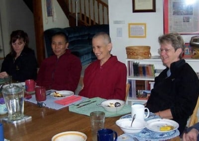 Venerable Chodron sits with guests at the lunch table