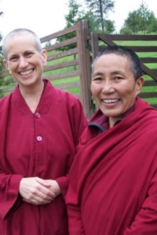 Venerable Chodron poses with a nun from the Tibetan Nuns project