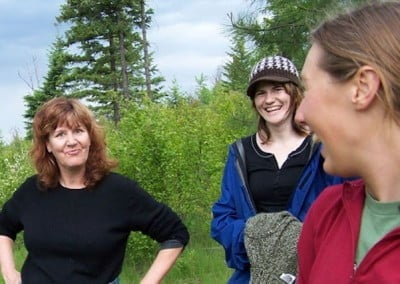 "Kathleen, Laresa and Savannah have a laugh after a steady walk up the <br> Abbey's ""Path of Ethics""."