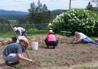 Some of the retreatants weed the garden in preparation for seeding and mulching the new beds.