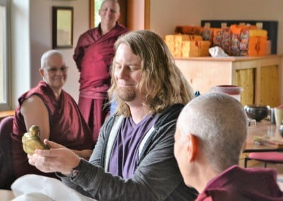 Koltz holding a gift from Venerable Chodron