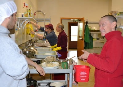Venerable Samten in the kitchen with several visitors