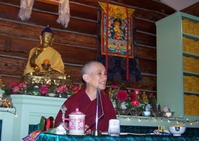 Venerable Chodron leads a puja in the meditation hall