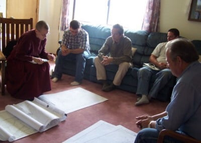 Contractors, engineers, and excavators meet with Venerable Tarpa to finalize designs and logistics.