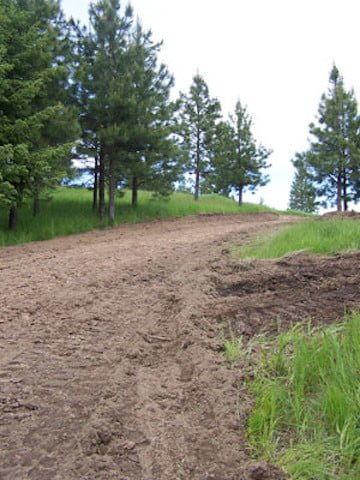 A dirt road that will give access to the site of the nun's residence in the event of a fire.