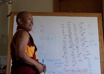 """ka, kha, ga, nga..."" Geshe-la teaches the Abbey residents the fundamentals of the Tibetan language for five of the days he is with us. Now we get to practice writing and pronouncing the unfamiliar symbols and sounds. It is great fun learning from such a wonderful teacher."