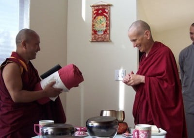 Venerable Chodron makes an offering to Geshe Namgyal