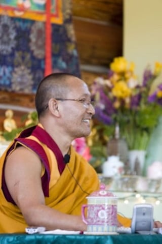 Geshe Namgyal teaches in the meditation hall