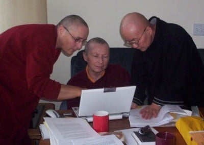 High tech bhikshunis writing up their research of Vinaya (monastic discipline)