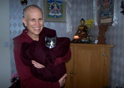 Venerable Chodron brings Maitri into Ananda Hall to visit with the retreatants.