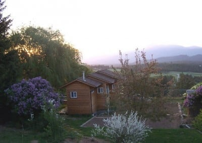 A serene sunrise greets early risers as well as the lilacs and spirea bordering Venerable's writing studio.