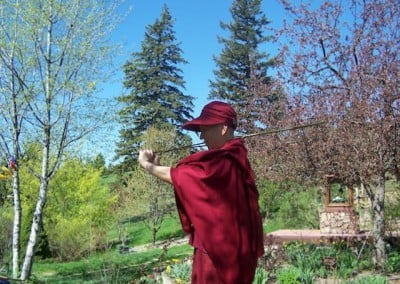 Venerable Chodron tries her hand at switching in the garden.