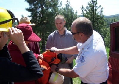 Chris, our fire chief, demonstrates some of the wildfire equipment firefighters use to protect themselves.
